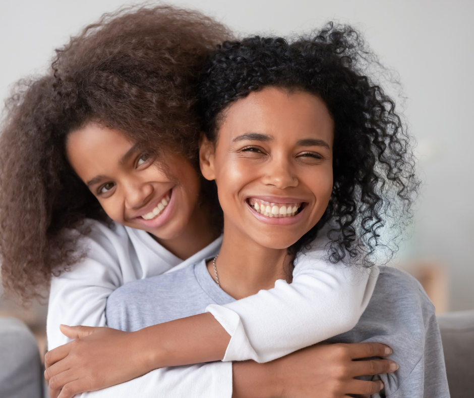 Image to Mum and Daughter smiling - relaxed and anxiey free